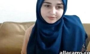 Hijab-wearing Muslim teen is masturbating on webcam