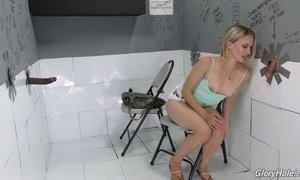 Blond bitch Riley Reyes is sucking huge mamba black penis in the glory hole room