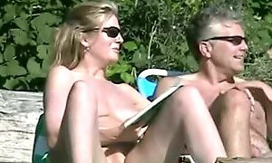 Mature pussy wide open on the beach captured on spy cam