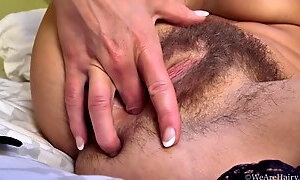 Melisa fingering her natural hairy pussy in solo masturbation scene